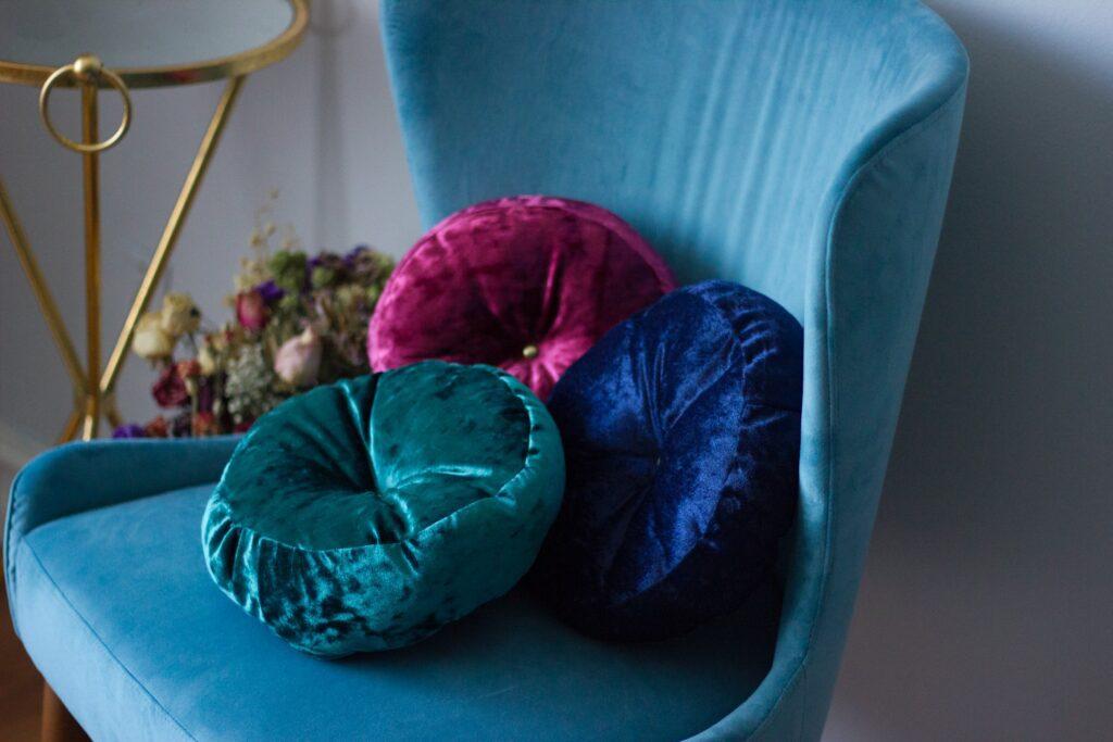 Velvet cushions and armchair